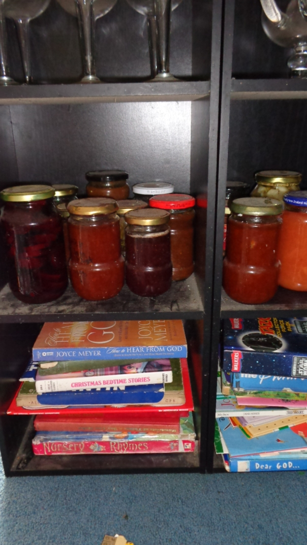 My infrequently used bookshelf stash of preserves