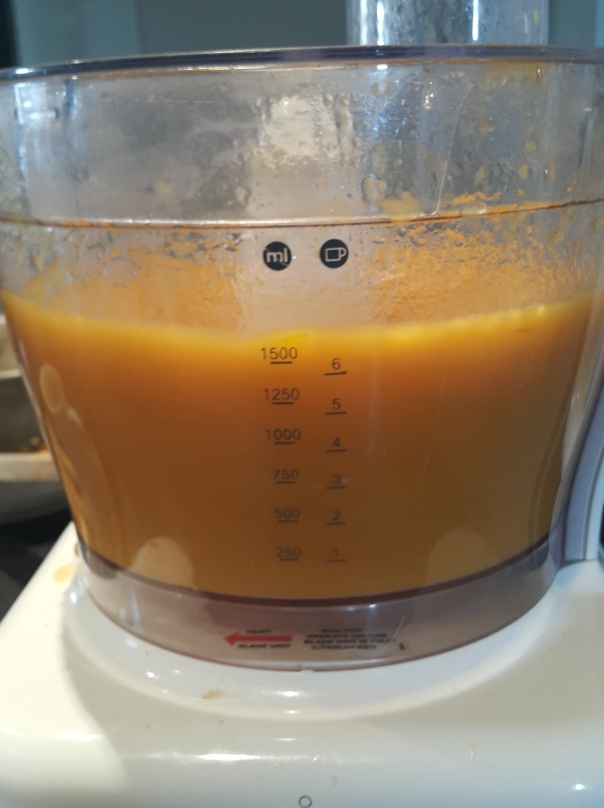 Yellow tomatoes in the food processor