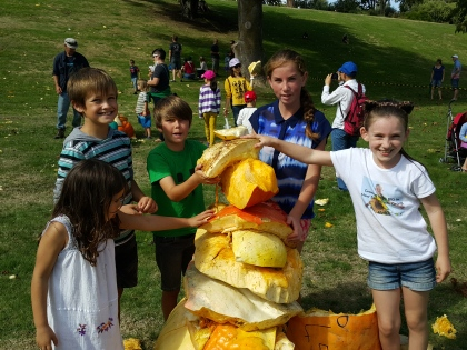 Tim, Joey and Grace from 'Growing Them Big In New Zealand With Grace' and friends build a great pumpkin carcass stack The Great Pumpkin Carnival