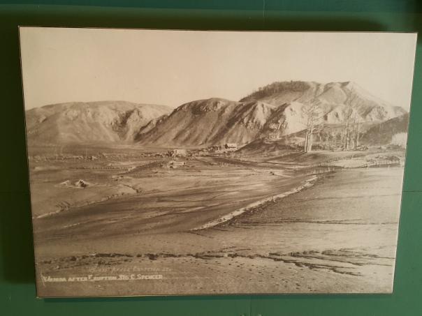 The total devastation, a village buried under a blanket of volcanic debris.