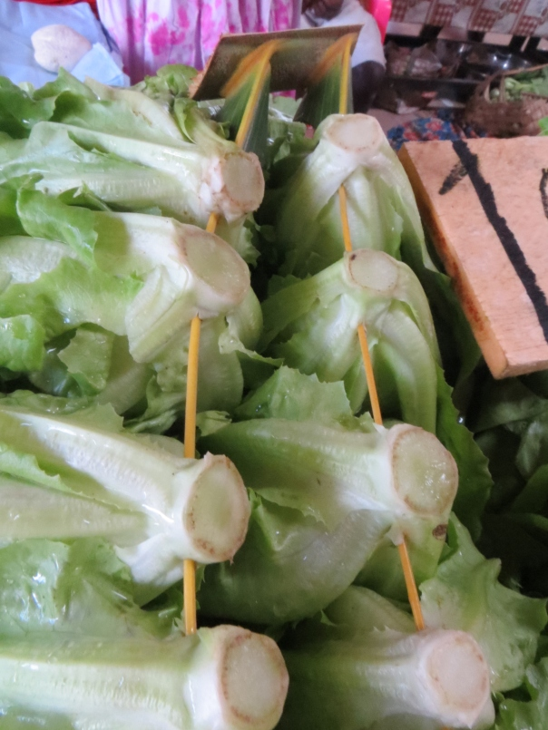 Lettuce threaded on to coconut leaves