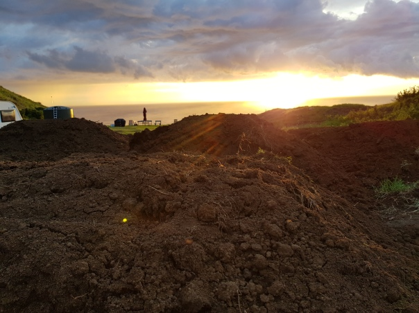 Sunset over dirt pile