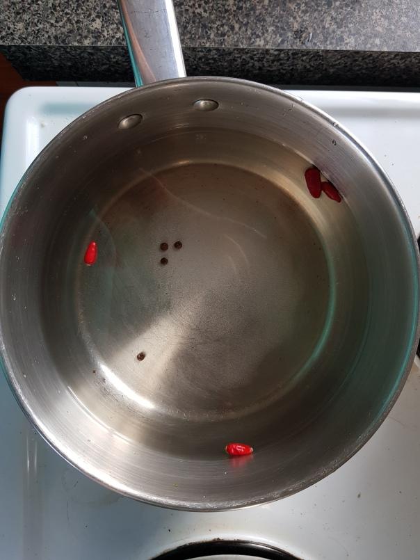 Chilli and peppercorns in vinegar